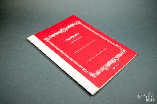 Life Comfort Notebook on Dark Background