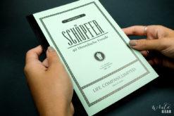Life Schopfer Notebook on Dark Background - Close