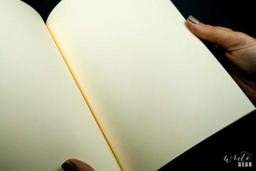 Life Schopfer Notebook on Dark Background - Paper Close